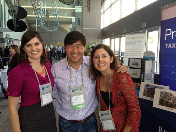 Kelsey Shaw, Tony Liou, and a client of Partner Energy, posing for a picture in between workshop sessions.
