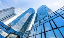exterior upward perspective of glass skyscrapers